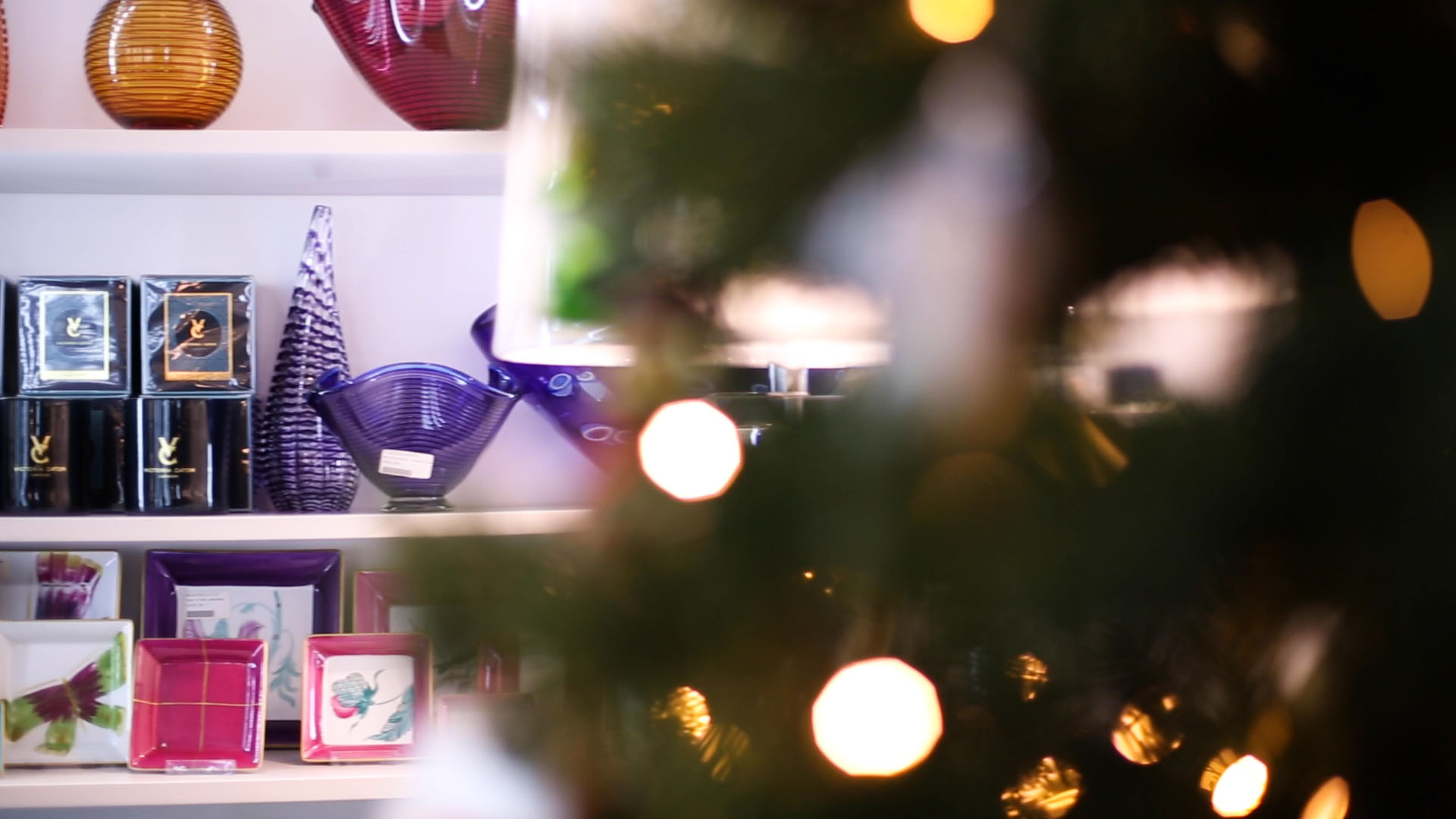 Video thumbnail. Christmas tree, lights and ornaments in a shop