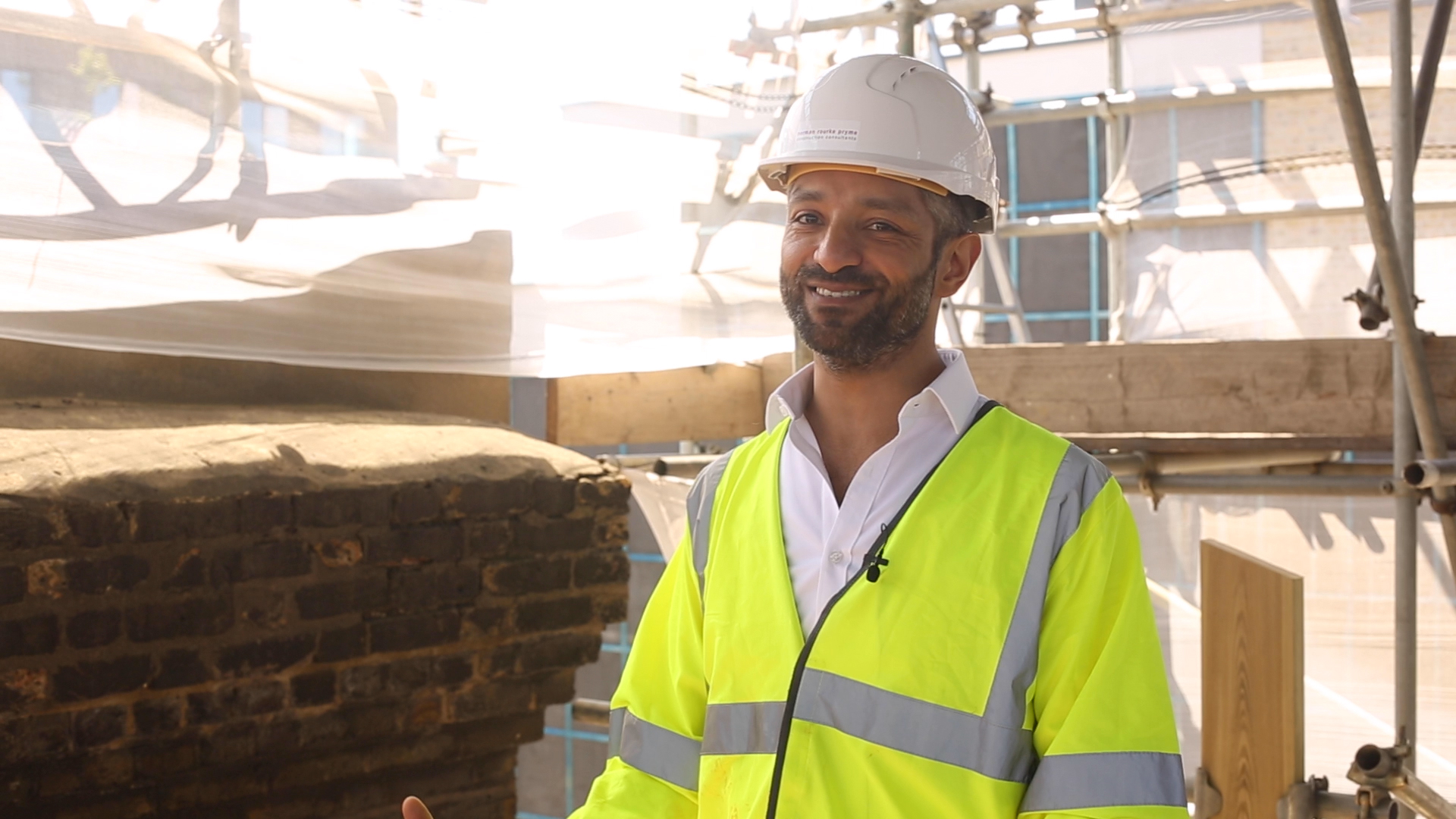 Video thumbnail. Man wearing PPE on building site