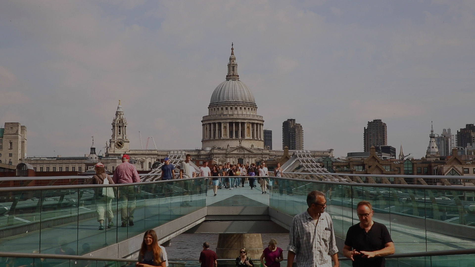 Header image. People walking over Millennium Bridge with Paul's Cathedral in the background